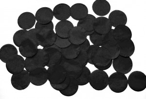 Black confetti around flame retardant